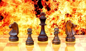 chessfire 18932044-chess-pieces-on-a-background-of-fire-take-off-the-gloves